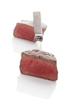 Delicious steak on fork.