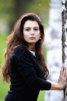 woman in birch forest