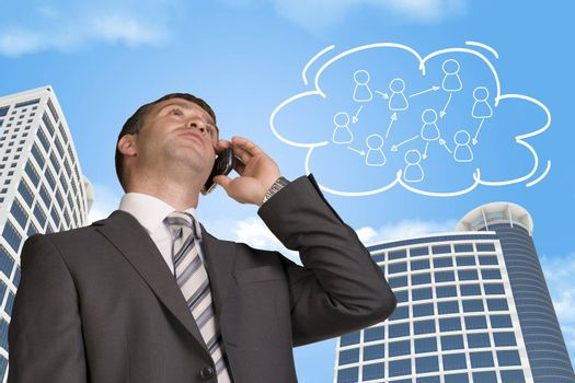Businessman talking on the phone. Skyscrapers and cloud with people icons in background