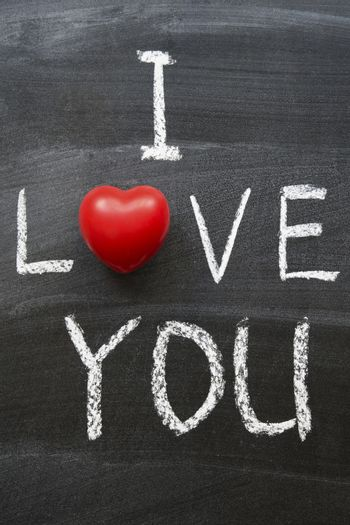 I love you phrase combined from handwritten symbols and red heart object
