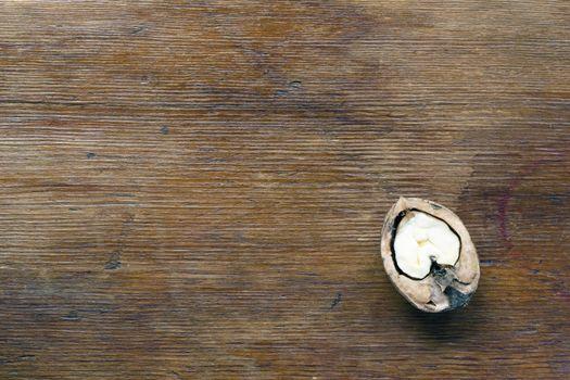 vintage wooden background with half-walnut on it