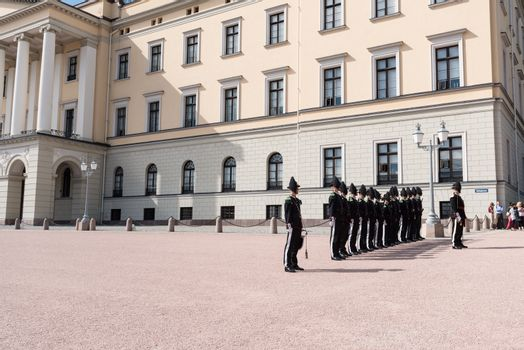 OSLO - AUGUST 28: In Oslo, His Majesty King's Guard keeps The Royal Palace and Royal Family guarded 24 hours day. Every day at 1330 hrs, there is Change of Guards outside Palace. Pictured on August 28, 2014