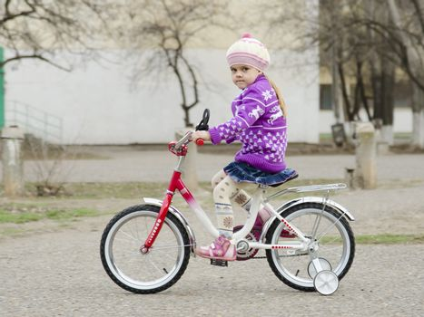 four year old girl goes on a Bicycle
