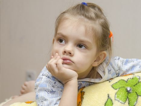 four year old girl enthusiastically look left