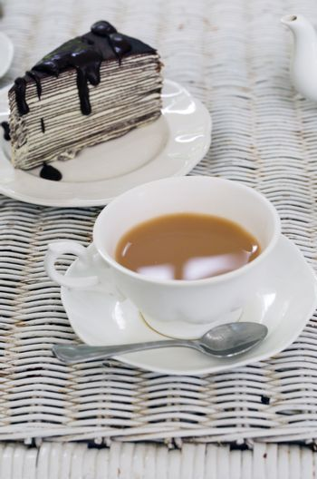A cup of tea with chocolate crape cake