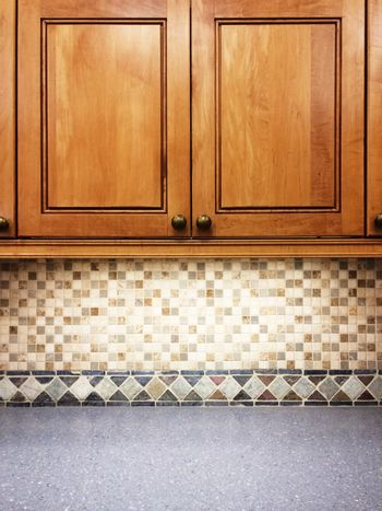 Kitchen with wooden cabinets and tile decor