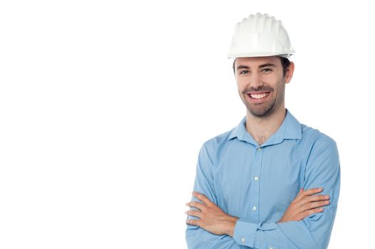 Architect standing with hardhat