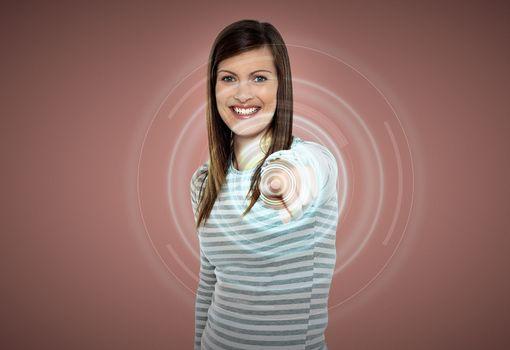 Attractive woman touching virtual screen