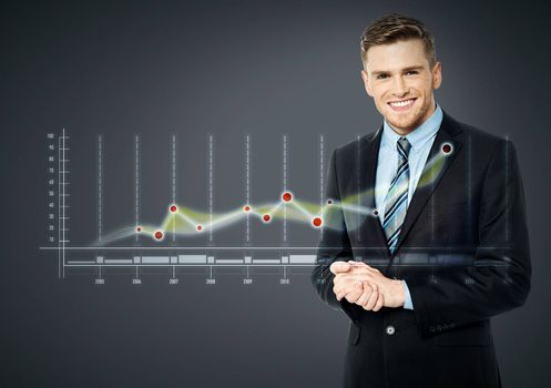 Young business man standing with digital graph report