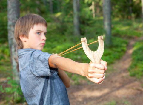 Kid with slingshot