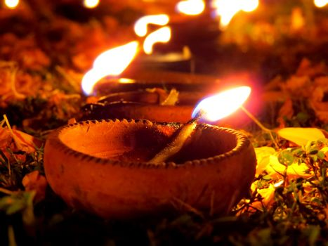 Traditional Diwali lamps lit in a garden on the occassion of Diwali festival in India