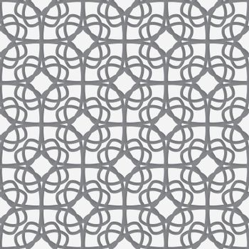 White geometrical ornament perforated with gray