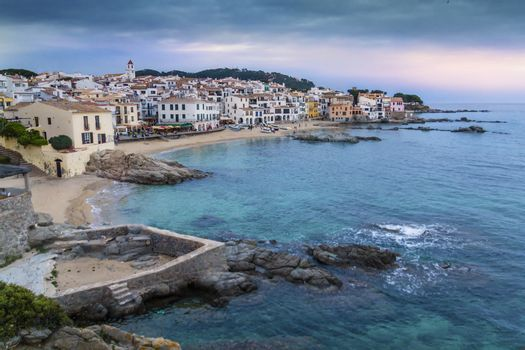 Little village of Girona (Spain) called Callela de Parafrugell, with a beautiful sky and sea, and white houses at the coast.