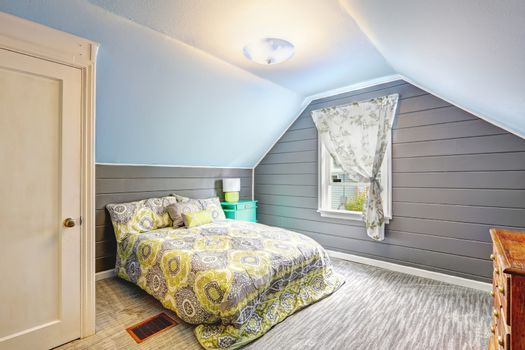 Bedroom with vaulted ceiling and plank paneled walls