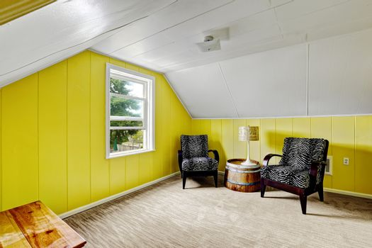 Bright yellow room with sitting area