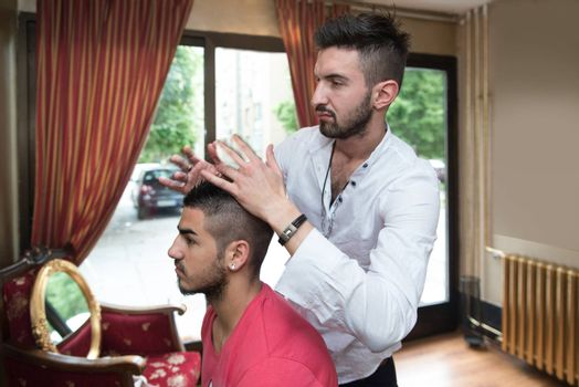 Hairdresser Preparing Young Man After A New Haircut