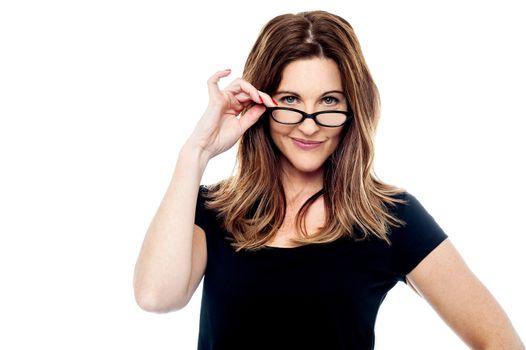 Beautiful woman holding her eyeglasses