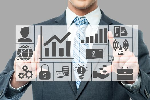 Graphs and charts analyzed by businessman