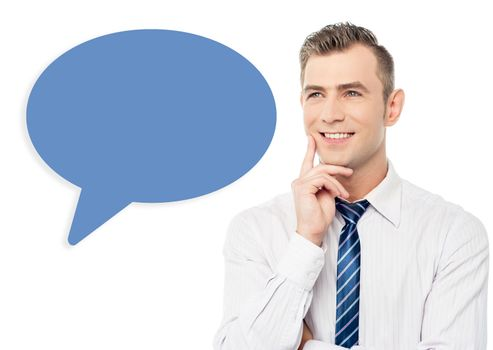 Young smiling man with speech bubble
