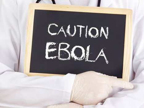 Doctor shows information: Ebola caution