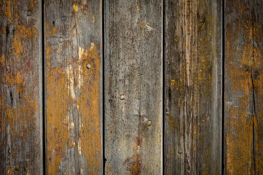 wooden background with weathered wood and ruusty nails