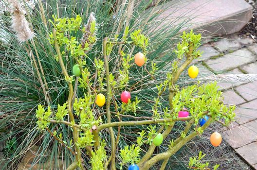 A flowering shrub in the garden decorated with Easter eggs simply part of Easter this.