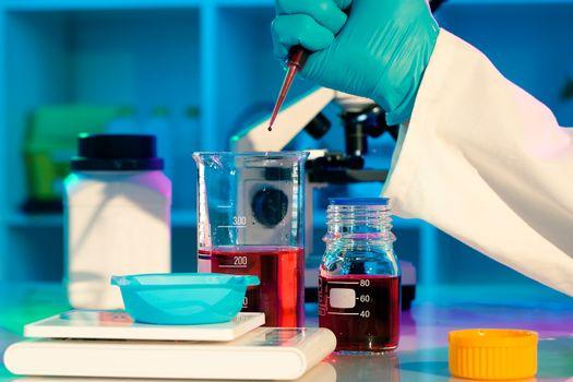 researchers work in modern scientific lab. Preparation of hazard