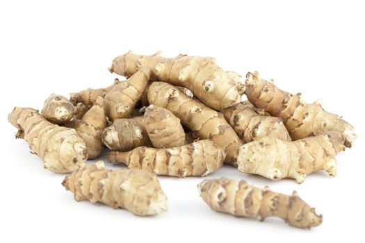 species edible tuber with root on white