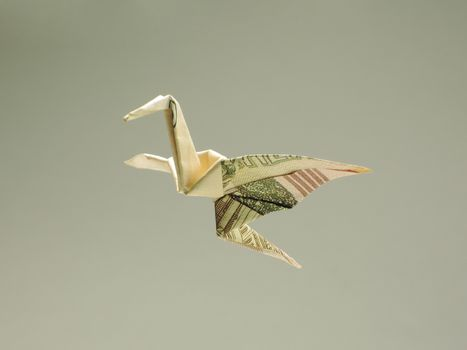 bird origami out of the money in the air