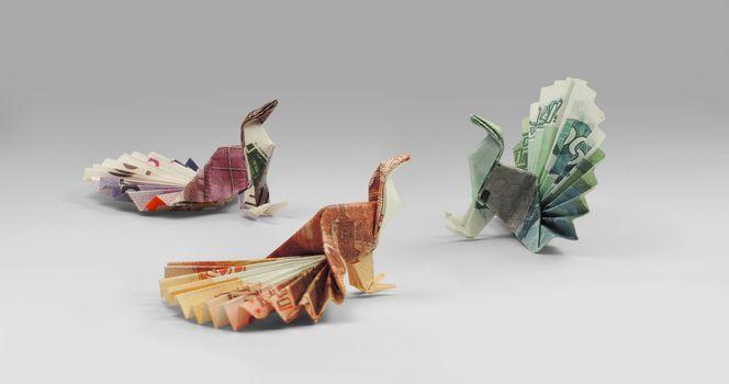 three bird origami banknotes walking