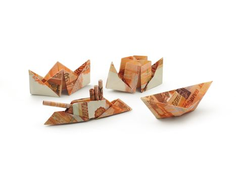 collection of origami ships of five thousands ruble banknotes