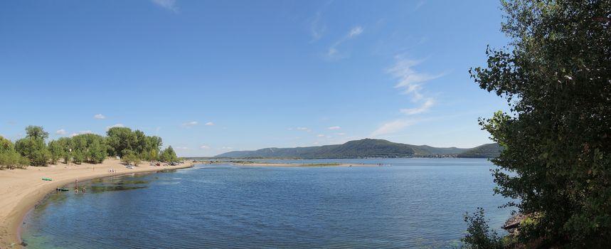 beach on the Volga River with mountain views