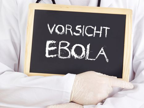 Doctor shows information: Ebola caution in german language