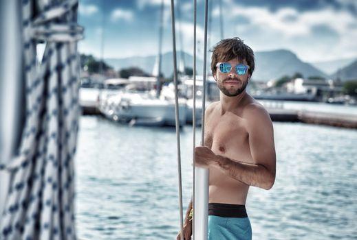 Sexy man on sailboat