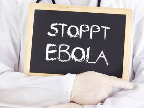 Doctor shows information: stop Ebola in german language