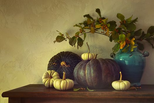 Fall pumpkins and gourds on table