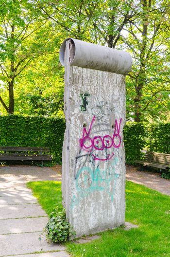 Mülheim Ruhr,Nrw, Germany - April 23, 2014:  Original member of the Berlin Wall with the typical Gafitti placed in the park, near Ringlockschuppen.