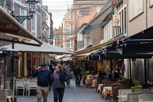 Dusseldorf Altstadt, Nrw, Germany - September 21, 2014: View of the famous Schneider Wibbel alley in the old town of Düsseldorf. In this small street there are many restaurants. In addition, the alley is one of one of the most beautiful small streets in the old town.
