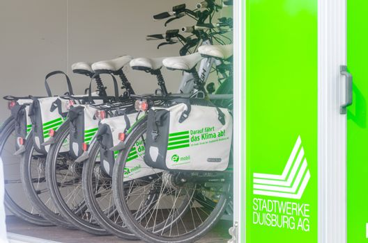 Duisburg, inland port, Germany - August 3, 2014: E bikes in a trailer. A progam of Stadtwerke Duisburg.  Cycling with bikes available.