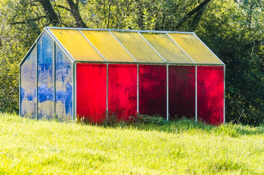 Heiligenhaus , Nrw, Germany - September 16, 2014: That color house 'Abtskuecher pond in the Holy House. To participate in the EUROGA In 2002, the art object by Birgit Hübner was erected.The artwork fits well to the landscape of