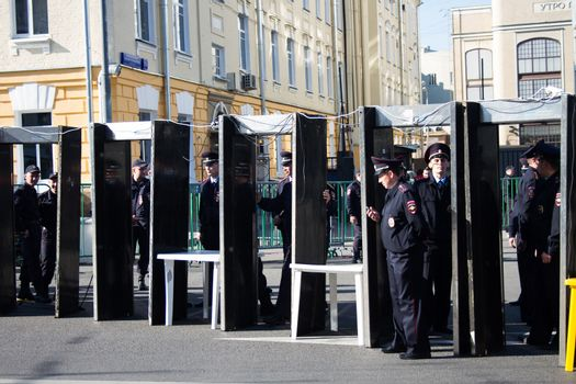 Moscow, Russia - September 21, 2014. Frame metal detectors police Peace March in Moscow against war with Ukraine