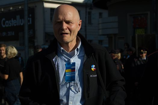 Moscow, Russia - September 21, 2014. Co-organizer of the March of peace Michael Schneider Peace March in Moscow against war with Ukraine