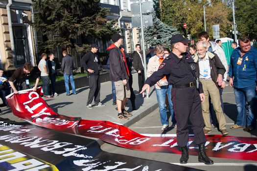 Moscow, Russia - September 21, 2014. Police confiscated some posters with peace March Peace March in Moscow against war with Ukraine