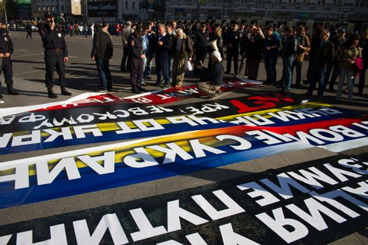 Moscow, Russia - September 21, 2014. Police chief Viktor Biryukov checks posters opposition peace March