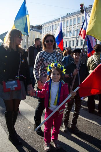 Moscow, Russia - September 21, 2014. The little girl in the Ukrainian wreath. Peace March in Moscow against war with Ukraine