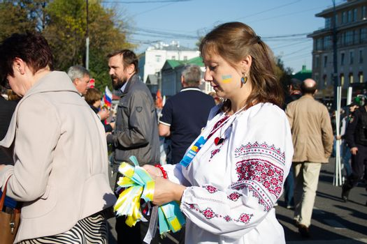 Moscow, Russia - September 21, 2014.  Peace March the girl in the Ukrainian national clothes Peace March in Moscow against war with Ukraine