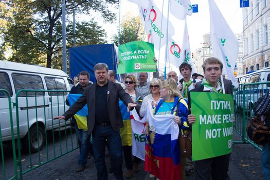 Moscow, Russia - September 21, 2014. The leader of the party Yabloko Sergei Mitrokhin. Peace March in Moscow against war with Ukraine