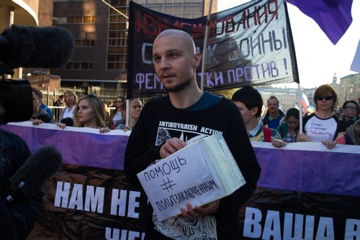 Moscow, Russia - September 21, 2014. Former political prisoner Vladimir Akimenkov Peace March against war with Ukraine