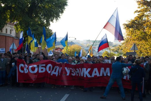 Moscow, Russia - September 21, 2014. A poster in support of political prisoners on the March for peace Peace March against war with Ukraine