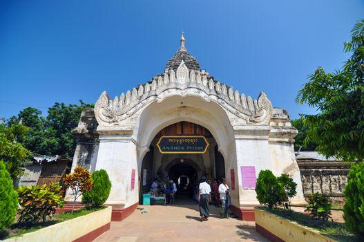 Bagan, Myanmar - October 9, 2013: Buddhist people visit Ananda temple